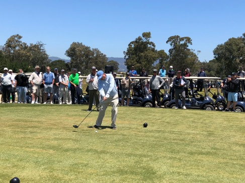 Rees Jones hits the ceremonial opening tee shot