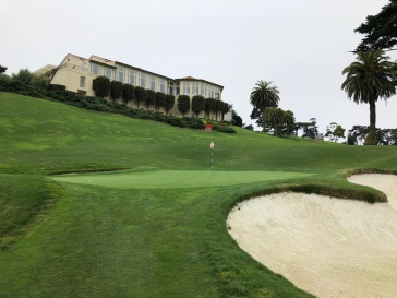 Closer view of 18th green with clubhouse above.
