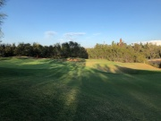 Side view of 16th green with Preston Castle in the background.