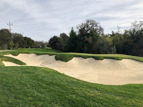 Side view of massive bunker guarding 8th green.