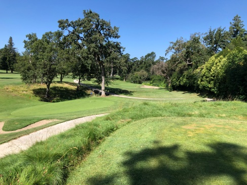Par-3 5th, which has you almost hitting directly over the 4th green.