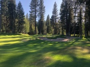 Closer view of par-3 16th green in the shadows.